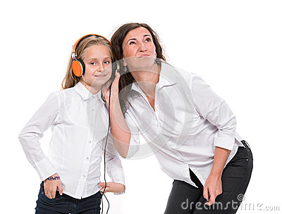 Little girl in headphones and her mother