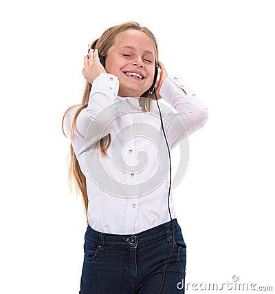 Little girl in headphones listening to music