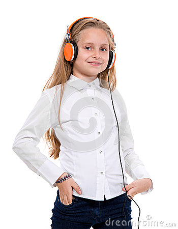 Little girl in headphones listening to music