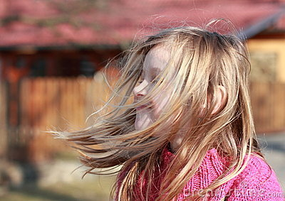 Little girl with hears flying in the wind