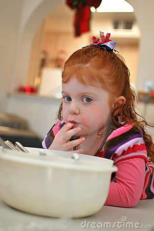Little Girl Helps Bake
