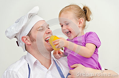 Little girl and her father having fun