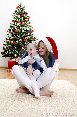 Little girl and her mom having fun at Christmas