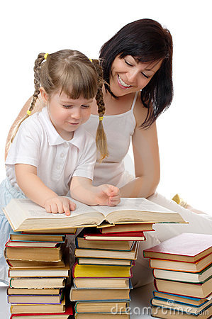 Little girl and her mother with books