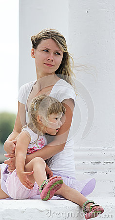 Little girl with her mother outdoors