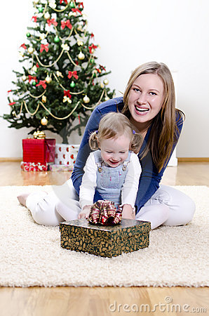 Little girl and her mother unpacks the gift