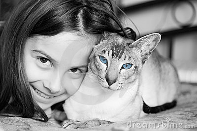 Little girl with her Siamese cat