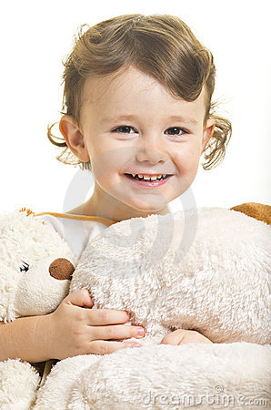 Little girl with her toy dogs