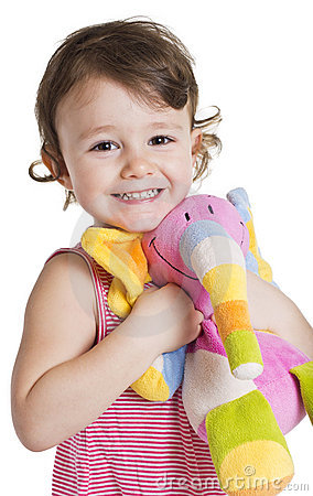Little girl with her toy elephant