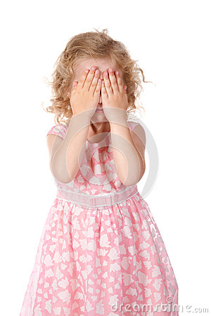 Little girl hide face under hands