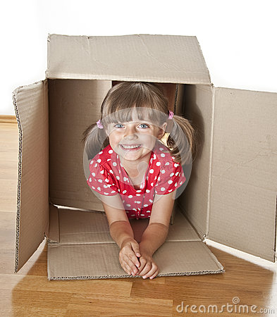 Little girl hiden inside a paper box