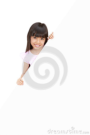 Little girl hiding behind a white board