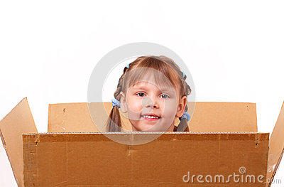 Little girl hiding in cardboard box