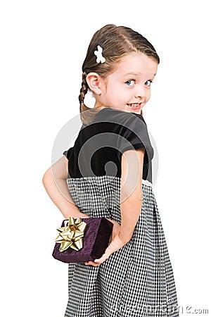 Little girl hiding gift