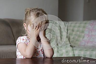 Little girl hiding her face