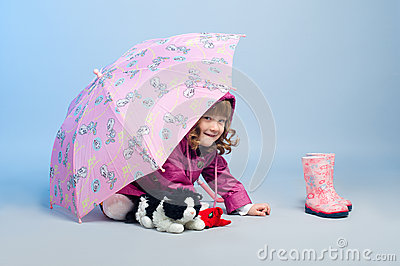 Little girl hiding by the umbrella