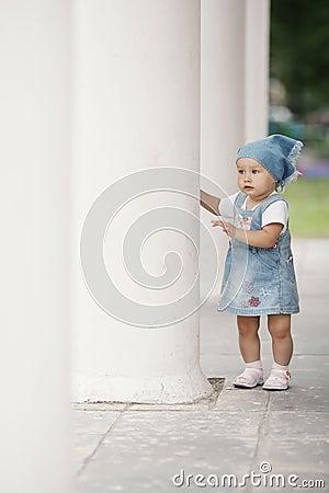 Little girl hiding in columns