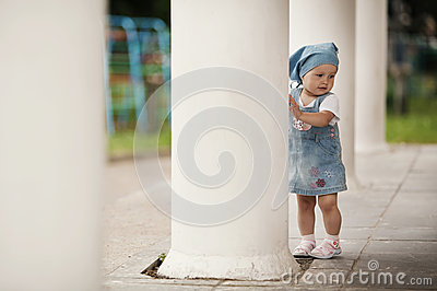 Little girl hiding in columns