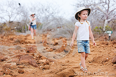 Little girl hiking at scenic terrain