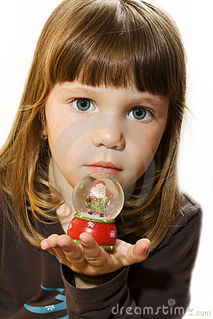 Little girl hold Santa claus figurine