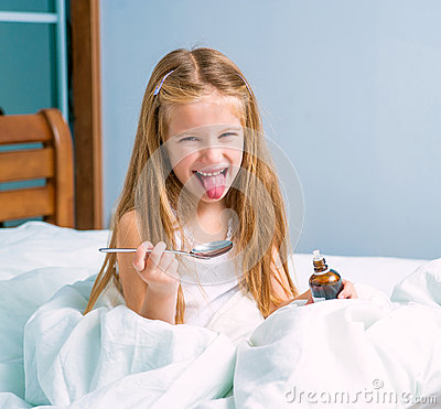 Free Little Girl  Holding A Cough Syrup Bottle Stock Images - 53670424