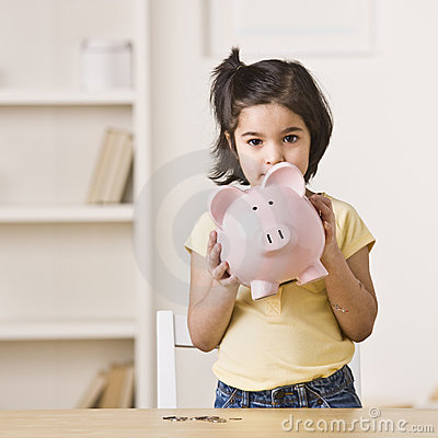 Free Little Girl Holding A Piggy Bank Royalty Free Stock Images - 10320659