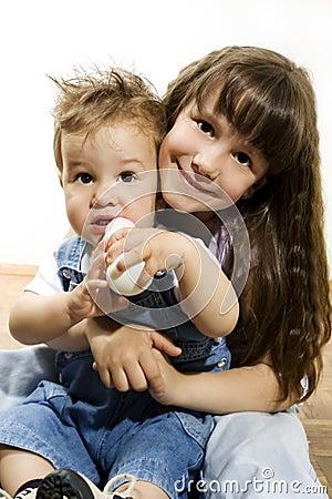 Little girl holding baby