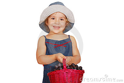 Little girl holding basket with grape