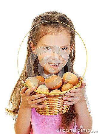 Little girl holding basket of raw