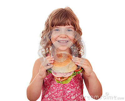 Little girl holding big sandwich