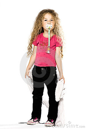 Little girl holding blanket with pacifier