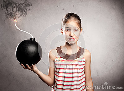 Little girl holding a bomb