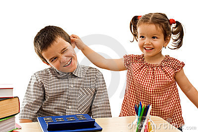 Little girl holding the boy by the ear
