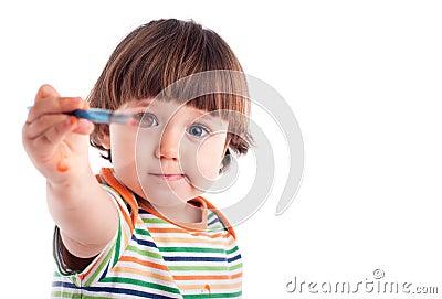 Little girl holding a brush