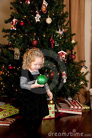 Little Girl Holding Christmas Ornamet