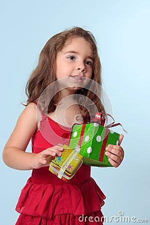 Little girl holding Christmas presents