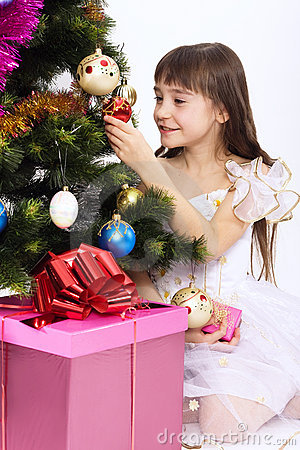 Little girl holding Christmas-tree decoration
