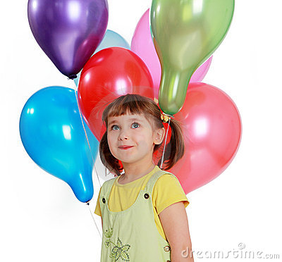 Little girl holding colorful balloons