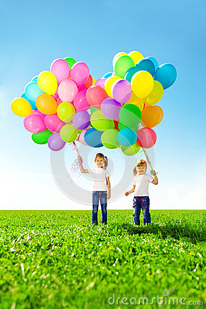 Free Little Girl Holding Colorful Balloons. Child Playing On A Green Stock Images - 39580744