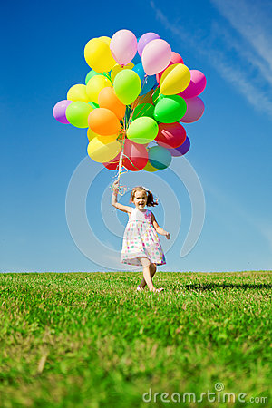 Free Little Girl Holding Colorful Balloons. Child Playing On A Green Royalty Free Stock Photo - 39586045