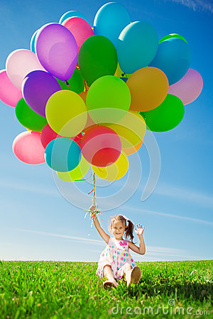 Free Little Girl Holding Colorful Balloons. Child Playing On A Green Stock Photography - 39622042