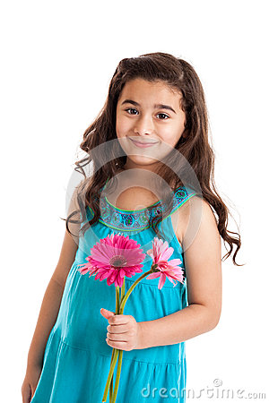Little girl holding daisies