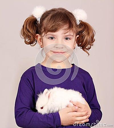 Little girl holding dwarf bunny
