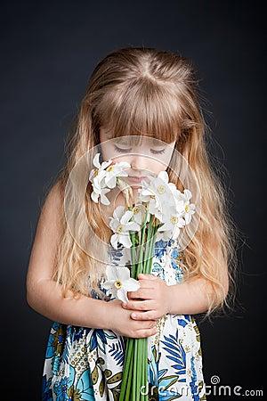 Little Girl Holding Flower