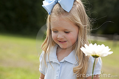 Little Girl Holding a Flower