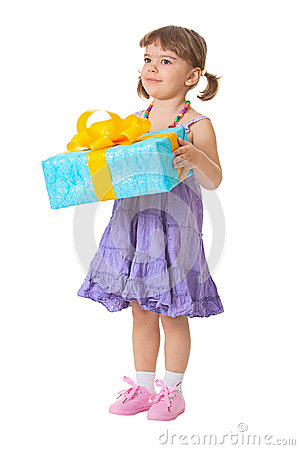 Little girl holding a gift - birthday