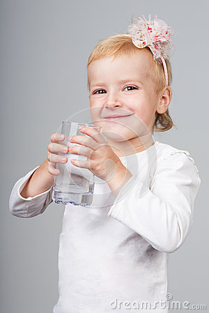 Little girl holding glass of water