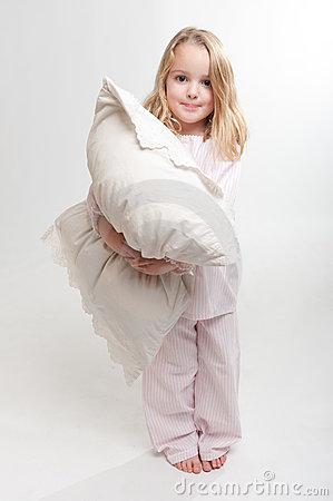 Little girl holding a pillow