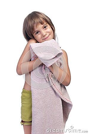 Little girl, holding pink blanket, studio shot