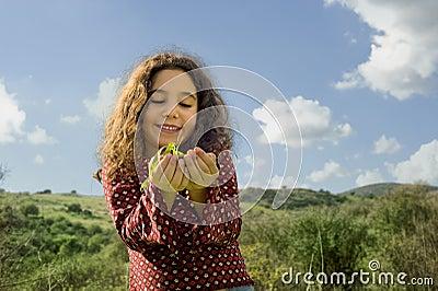 Little girl holding plant